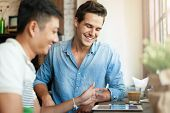 stock photo of internet-cafe  - Two Men Using Tablet Computer Internet - JPG