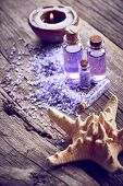 foto of gels  - Spa with starfish purple shower gel and candle on wooden background - JPG