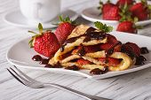 stock photo of crepes  - Homemade crepes with strawberries and chocolate close - JPG