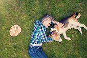 stock photo of beautiful senior woman  - Beautiful senior woman lying on a grass in a park - JPG