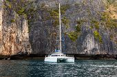 stock photo of phi phi  - a luxurious catamaran floating on the clear waters of phi phi island Thailand - JPG