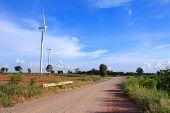 stock photo of generator  - Wind turbine power generator and straight road - JPG