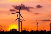 stock photo of generator  - Wind turbine power generator at twilight sunset - JPG