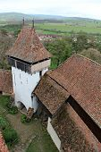 picture of fortified wall  - Medieval fortified church surrounded by defence walls - JPG