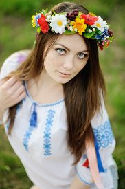 picture of freckle face  - girl with freckles on her face in a Ukrainian shirt and floral bouquet on the head - JPG