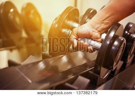poster of Sport equipment in fitness room or gym room, relax room for healthy people, Dumbbell in fitness and gym room,sport relax and healthy life, favorite sport or private sport in indoor or sport complex.