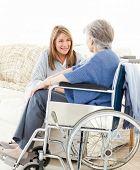 Seniors talking together in the livingroom poster