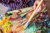Brush And Oil Paints On A Palette, Paint A Picture Of The Artists Hands, Texture Mix Paint In Diffe poster