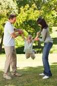 picture of happy family  - Portrait of a joyful Family In The Park - JPG
