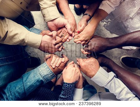 poster of Group of diverse hands holding each other support together teamwork aerial view