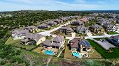 New Suburb Development In Dripping Springs , Texas , Usa Aerial Drone View High Above Houses And Hom poster