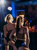 Two Girls Dancers In Black Erotic Costumes Perform At A Party poster