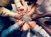 Group of diverse hands holding each other support together teamwork aerial view poster