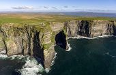 Beautiful Scenic Aerial Drone View Of Ireland Cliffs Of Moher In County Clare. Sunset Over The Cliff poster