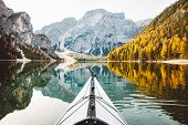 Beautiful View Of Kayak On A Calm Lake With Amazing Reflections Of Mountain Peaks And Trees With Yel poster