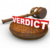 The word Verdict on a wood block with a gavel beside it, representing the final decision, judgment,