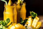 Jars Of Mango Juice And Mango On Wooden Table Background With Ice. Resfreshment Summer Drink. Select poster