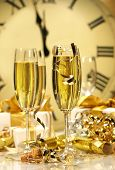 stock photo of champagne glasses  - Champagne glasses ready to bring in the New Year - JPG