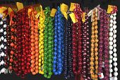 stock photo of kukui nut  - Hawaiian Kukui Nut Beads for sale in the city of Kona Hawaii - JPG