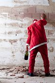 stock photo of puke  - Staggering Drunken Santa Holding on a Wall - JPG