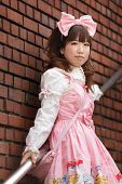 stock photo of lolita  - japanese lolita cosplay posing on stairs - JPG