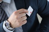Closeup Of Mans Hand Pulling Ace Card Out Of Suit Pocket. Businessman In Stylish Outfit. Male With G poster