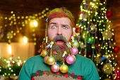 Confused Bearded Man With Decorated Beard. Christmas Beard Decorations. New Year Party. Bearded Man  poster