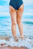 In The Frame Of A Womans Feet Walking On The Beach By The Sea On A Sunny Day In A Tropical Hotel On  poster