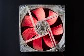 A Computer Fan With Red Blades Is Covered With A Thick Layer Of Dust On A Dark Background. The Conce poster
