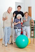 foto of zimmer frame  - Portrait of disabled senior people with trainer showing thumbs up sign - JPG