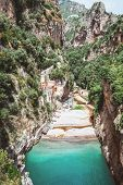 Breathtaking Destination Scenic View Of Fiordo Di Furore In Italy With Blue Green Water And Old Vill poster