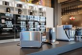Brand new toaster, kettle and food processor in apliance store showroom, ovens and other home applia poster