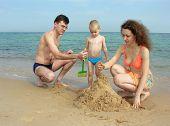 Family Build Sand Castle On Beach poster