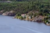 Typical Swedish nature and houses on the shore of the fjord. View from the high bridge over the fjor poster