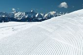 Winter mountains panorama with ski slope poster