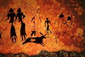 stock photo of hieroglyphs  - Cave painting of primitive commune on the wall - JPG