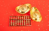 Chinese new year ornament--gold ingot and golden abacus,Chinese calligraphy Translation:good bless f poster