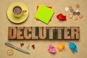 declutter - abstract in vintage letterpress wood type blocks with coffee, sticky notes, coins, pen,  poster