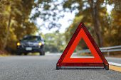 Black Car Have Accident Park On Road. Red Triangle, Red Emergency Stop Sign, Red Emergency Symbol An poster