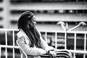 True Tilt-shift Black And White Portrait Of A Young African Female With Braids And Earring, Sitting  poster