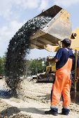 picture of road construction  - Worker and road loader on construction of road - JPG