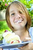 Girl Eating A Cake