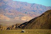 Residential Home In A Vast Arid Valley Besides Mountainous Terrain Taken In The Rugged Great Basin D poster