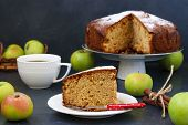 Pie With Apples, Cinnamon And Ginger On A Dark Background, With Piece Of Cake And Cup Of Coffee In T poster