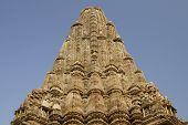 picture of kandariya mahadeva temple  - Sculptures of religious figures decorating the walls and tower of the ancient Kandariya Mahadeva Hindu Temple at Khajuraho Uttar Pradesh India - JPG