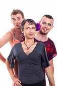 picture of transvestites  - Portrait of three smiling transvestites cross - JPG