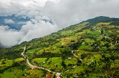 foto of long winding road  - High altitude road winding through a sparsely populated valley - JPG