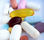 picture of valium  - Close up of a variety of prescription drugs and vitamins on a bluish hospital like background - JPG