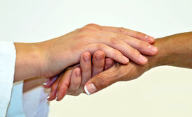 picture of compassion  - Two female hands clasped in compassionate hold - JPG