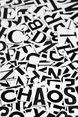 stock photo of riddles  - Macro shot of a clipped letters formed the word chaos - JPG